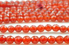 62 pcs of Natural Carnelian faceted round beads in 6mm by YesBeads