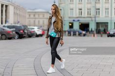 Russian model Kate Fedulova wearing an olive jacket, Furla bag, black leather pants and white sneaker on October 14, 2016 in Moscow, Russia.
