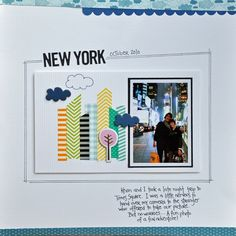 """A custom skyline from washi tape, by """"it's just me"""".  The lines around the photo and title are drawn at an angle, mimicking the buildings, and the page is  topped off with a cloud pattern."""
