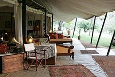 """1920 Safari Camp"" located in Kenya's Masai Mara, bordering the Serengeti, was founded in 1919 & has been in continuous operation by 4 generations of the Cottar family. The camp - furnished in classic British Colonial style - maintains the original essence of 1920's colonial Africa."