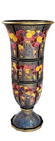 A French ceramic vase by Odette Chatrousse-Heiligenstein. This spectacular and unique tulip shaped vase rests on a circular heel with a polychrome ceramic lapis background. The vase is adorned with fall colors in circles interspersed all over. Circa 1925.