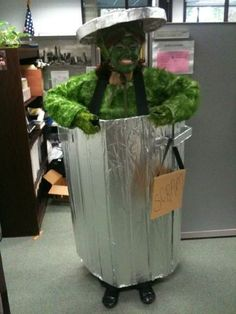 Oscar the Grouch ... @Lauren Nicole can I be this next year for Mickey's party? I think it fits me quite well!