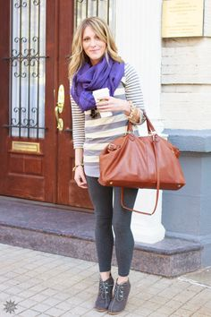 Create a comfortable and fashionable fall look with simple wardrobe pieces like leggings, a sweater, a scarf, and a stylish bag.