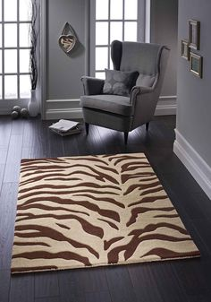 Hand tufted pure wool rug. Impressive and unique design element for added style quotient. #woolrugs #beigerugs #brownrugs #brownwoolrugs #beigewoolrugs #designerrugs #modernrugs #largerugs