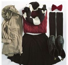 Girly Winter Outfit: knitted sweater, army jacket, black skirt, knee high socks, and doc martens