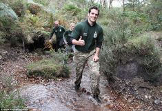Happy chappy: Henry gave the thumbs up as he waded through a stream with his team close be...