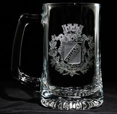 Family Crest Beer Mug, Engraved Coat of Arms Mug - One Mug - (crest). Personalized Family Crest Beer Mug has an old world european style generic family crest engraved into the glass with name. A great gift for the home bar, mancave or as a birthday gift or retirement gift for the classy man who has everything. Deeply carved using our sand carving technique, each of our custom beer mugs is meticulously custom made to order making it the perfect gift for those seeking unique gift ideas for...