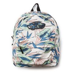 The Vans Realm Tropical Women's Backpack is a 100% cotton two-pocket backpack with an allover print. Measuring 16.75 L x 12.75 W x 4.75 D inches, it features a zippered main compartment, a front organ