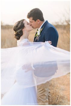Bride and groom! Navy suit and white dress! Charl vd Merwe Photography