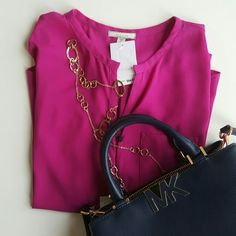 Pleione Magenta Blouse Great top for work. Beautiful dark Magenta  color. The camera and lighting did not allow for the true color to come out. Please see last pic the true color resembles a lot to the purple in the flower. Pocket on left side, long sleeves.  100% Polyester Pleione Tops Blouses
