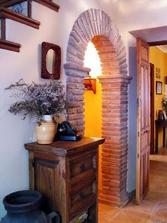 brick archway for dinning room arches. I like the  this has a pillar look to it to add interest and variation to an otherwise evenly bricked archway.