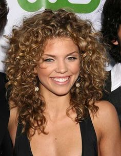 Naturally Curly Medium to Short Hairstyle for Women