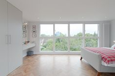 50 Degrees North Architects dormer loft conversion project in South West London. Open-plan master bedroom suite flooded with light. Home Fix, House, Loft Conversion, Home, Windows And Patio Doors, Home Renovation, Loft Room, Main Bedroom, Loft Inspiration