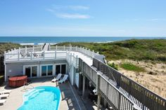 Blue Crush , KD08. Oceanfront in Kill Devil Hills Rentals. 10 bedrooms, 10 full baths, 3 half bath. Beds made: 9 kings, 2 bunk sets. Bath towels provided. Elevator, hot tub, pool, WiFi. 'Blue Crush' is a A FABULOUS home for special events and corporate groups!  Parking is available for 7-8 cars. Non-Smoking. No Pets.
