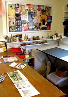 I like that big bulletin board to put ideas or inspiration for art projects. art studio craft room I love the inspiration wall