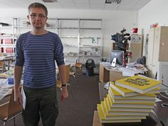 French cartoonist Charb, publishing director of French satirical weekly Charlie Hebdo, poses for photographs at their offices in Paris, September 19, 2012.
