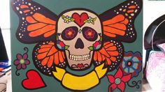 Sugar skull with butterfly wings by J. Chouteau