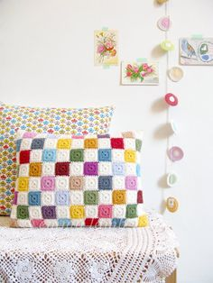Luella, multi colored geometric patchwork crochet cushion cover, granny chic home decor -  by Emma Lamb (love the white between each square. Maybe use this style on a blanket?)