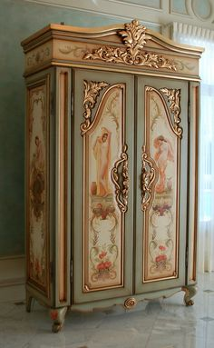 hand-painted 'french armoire' with goldleaf gilding, panels