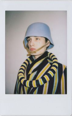 Walter Van Beirendonck backstage polaroids. Male model in stripy suit. http://www.dazeddigital.com/fashion/article/18605/1/polaroid-obsessions-walter-van-beirendonck