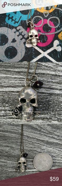 Skull with a rose sterling silver necklace Never worn before.Reminds me of King Baby. It has been in my jewelry box forever. I bought at an artist fair in Scottsdale, AZ. Sterling silver skull. Has a second pendant on it that is a dark purple raw amethyst. Comes on a box chain that is made in Italy. Is stamped 925. I like the patina but you might want to silver clean it if you don't like it. Chain is 18 inches. king Baby Jewelry Necklaces
