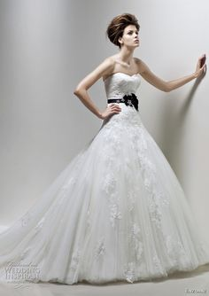 This is my dress, minus the sash. I think it cuts the dress weird and looks much more romantic without. Pretty excited :)