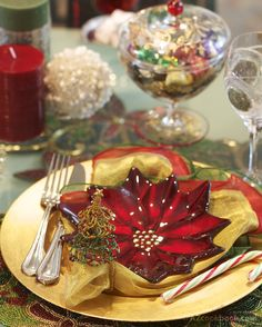GOLD CHARGER, CANDY CANE, GOLD NAPKIN, SILVERWARE AND RED POINTSETTIA BOWL