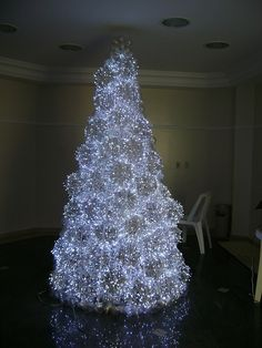 Christmas Tree made from PET bottles and LED lights,would love to know how many bottles it took to make this and what the frame is made of,very pretty