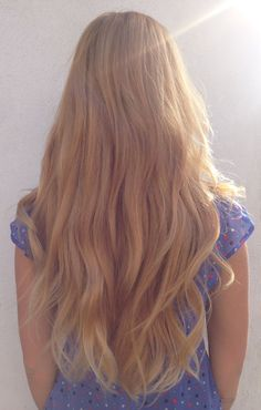 Long golden strawberry blonde hair with balayage highlights