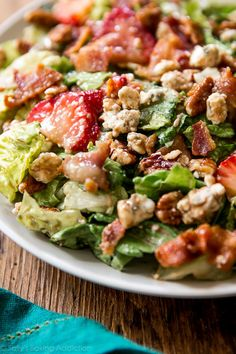 Perfect for warm weather, parties, lunch, and a light dinner! Sweet, savory, and simple strawberry bacon salad. Try adding grilled chicken! sallysbakingaddiction.com