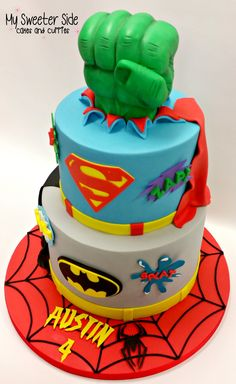 Superhero Cake Superhero birthday cake.Cakes covered in fondant with fondant decorations. The Hulk fist is RKT covered in modeling...