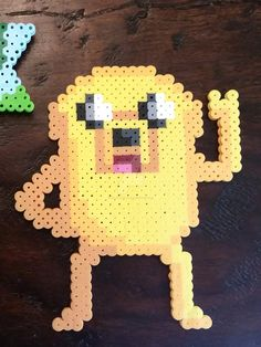 Fuse Beads: Jake the Dog by right2bearcharms on deviantART | Adventure Time character. Perler brand beads.