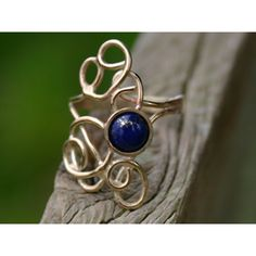 Gold and lapis lazuli ring - Rings found on Polyvore -- Would prefer silver