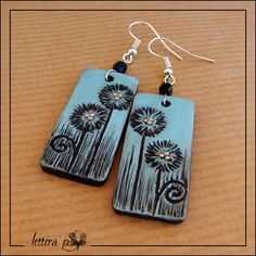 "From my collection ""Impronte"" (2011): handmade earrings in polymer clay. On surface I impressed drawings from my sketchbook."