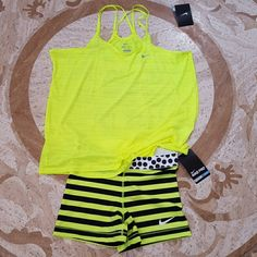 BN Nike Pro Neon Set Top and bottom brand new with tag. Top has a small cut as shown on picture it is on the front right bottom of the top. Both are brand new and never worn. Shorts are too short for my liking. Color is like highlighter yellow Nike Tops Tank Tops