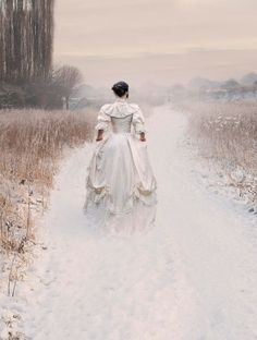Photography: Victorian Woman Walking Through A Winter Meadow, by Lee Avison.