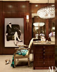 Mayer's dressing room features an Ochre chandelier, a Boo Ritson photograph, and a Porta Romana sconce | archdigest.com