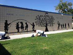 Part of our Youth Conference Service Project - painted this mural on the elementary school wall in a low income neighborhood.