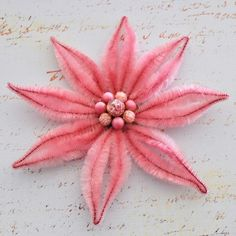 "Poinsettia made out of vintage chenille pipe cleaners and vintage jewelry. Use it as an ornament or turn it into a hair focal, brooch or magnet. One of a kind. 7"" diameter with 1.5"" diameter blank wood backing"