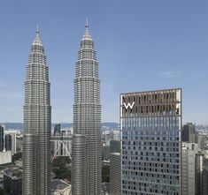 This luxury hotel combines the bold, vibrant design and dynamic lifestyle programming that W is known for globally, but with a unique Kuala Lumpur twist. It offers 150 rooms, several bars and restaurants, a spa and rooftop swimming pool - all with Petronas Towers views. Local Hotels, Hotels And Resorts, Kl Hotel, Petronas Towers, Renaissance Hotel, Putrajaya, Stay The Night, Resort Spa