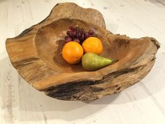 A truly lovely teak bowl and would make a statement whatever it is used for. This unique solid structure would look fabulous filled with tropical fruit... imagine pineapple, mango & kiwi fruit, or just a glorious piece of teak root showing off the wood grain. Finished with a white wash paint, this bowl has Scandi style and as each piece is unique you will have a one of a kind design. Incredibly solid and well made piece. Feature outside or indoors!