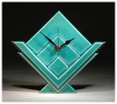 Handmade ceramic wall clock in an Art Deco style. Designed and made by Malcolm and Russell  Akerman of Echo of Deco.