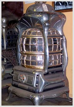Antique cast iron parlor heater, burns wood or coal.