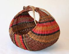 Fallow Earth -- Hen Basket. Hand-dyed reed, coir, and mule deer Antler. From Jeffers Fine Art.com - Pat Jeffers' Gallery