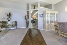 Silver bureau adds glamorous counterpoint to architectural beams in this 55+ community.