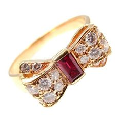 Yellow Gold Diamond Ruby Bow Motif Ring by Van Cleef Arpels. With 16 round brilliant cut diamonds, VVS clarity, F color. Van Cleef Arpels, Van Cleef And Arpels Jewelry, Ruby Jewelry, Jewelery, Fine Jewelry, Jewelry Rings, Ruby Diamond Rings, Diamond Cuts, Antique Jewelry