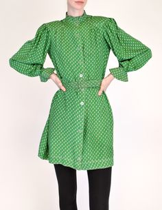 """Jean Muir Vintage Green Geometric Button Up Tunic Dress - from Amarcord Vintage FashionJean Muir London, 1970s, Green Geometric Button Up Tunic Dress - from Amarcord Vintage Fashion. """"Vivid green silk w/ grey geometric pattern throughout. Sitch details along collar, shoulders, and cuffs. Plastic button up front with matching fabric belt, lucite buckle. Pockets at hips."""" 100% silk. Priced at $795.00. Sold.."""