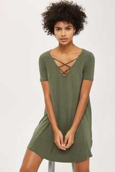 Look on-trend in this lattice front swing dress. This khaki number falls above the knee and comes with short sleeves. It's perfect for layering into daytime looks.