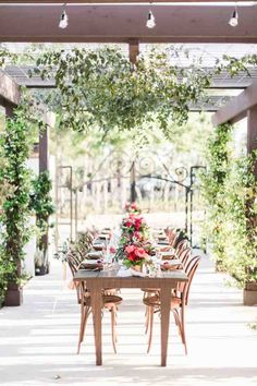outdoor wedding reception tablescape at garden with colorful pink and red flowers