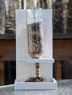 Gravity does most of the work in this clever bird feeder. After building the frame, just fill the empty wine bottle and invert; then call birds to the table.